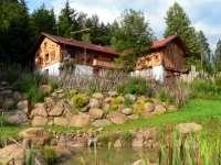 gruber-ferienhuetten-bayerischer-wald-almhuetten-ferienhuetten-ansicht-klein